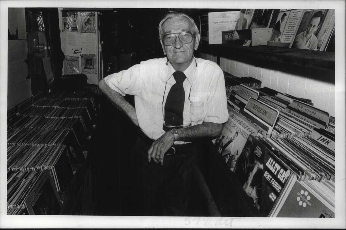 Proctor Arcade, Schenectady, New York - Harold E. Rieck with his many records at Hal-Lo Square record store. July 10, 1987 (Tom LaPoint/Times Union Archive)