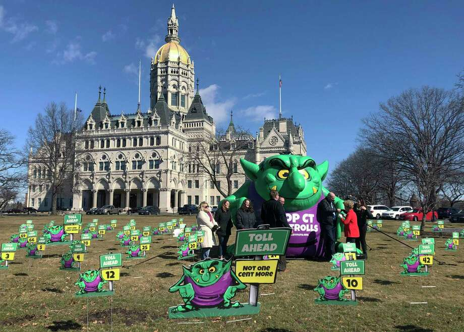 "Opponents of highway tolls in Connecticut pose in front of an inflatable ""Toll Troll"", Tuesday, March 19, 2019, outside the Connecticut State Capitol in Hartford, Conn. The conservative Yankee Institute for Public Policy organized the protest ahead of a planned committee vote on tolls. (AP Photo/Susan Haigh) Photo: Susan Haigh / Associated Press / Copyright 2019 The Associated Press. All rights reserved."
