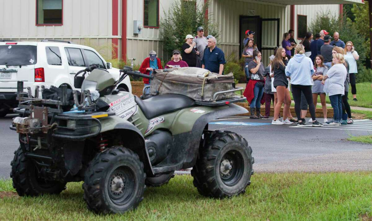 Community members gather to help search for 15-year-old Ryder Cambron as a helicopter flies overhead, Wednesday, Sept. 18, 2019. The Magnolia teen went missing Tuesday night after she went for a ride on an off-road vehicle near a wooded area in Montgomery County.