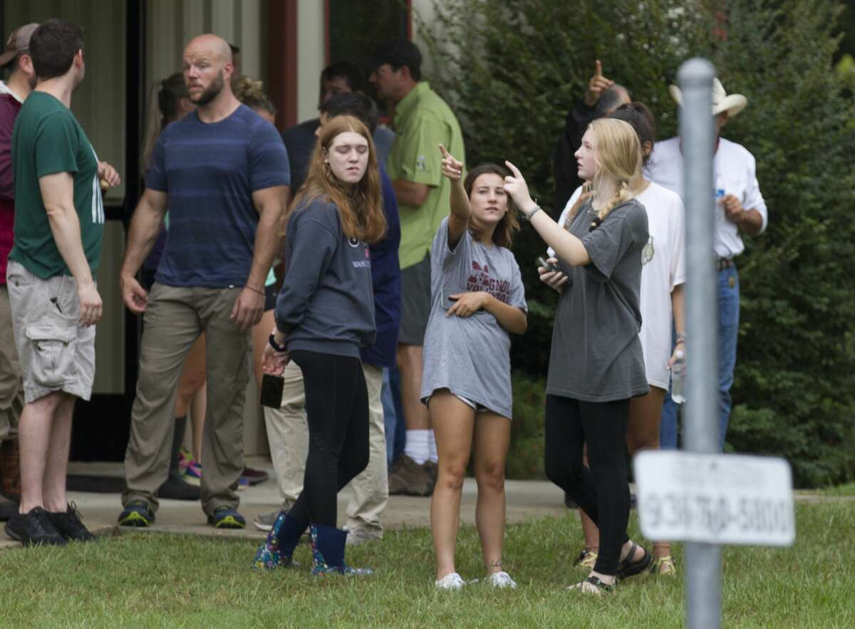 Community members gather to help search for 15-year-old Ryder Cambron, Wednesday, Sept. 18, 2019. The Magnolia teen went missing Tuesday night after she went for a ride on an off-road vehicle near a wooded area in Montgomery County.