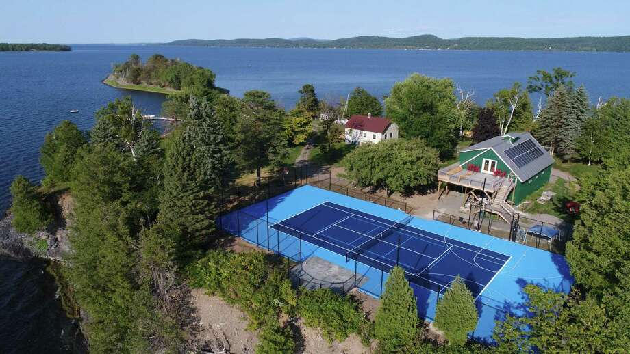 A sports court or field can be built almost anywhere — even on a private island, such as this one in Vermont — as long as there is enough planning, says Ryan Conroy, sales and marketing manager at Woodbury-based Classic Turf Company. Photo: Classic Turf Company, LLC / / Connecticut Post
