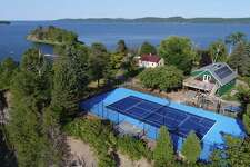 A sports court or field can be built almost anywhere - even on a private island, such as this one in Vermont - as long as there is enough planning, says Ryan Conroy, sales and marketing manager at Woodbury-based Classic Turf Company.