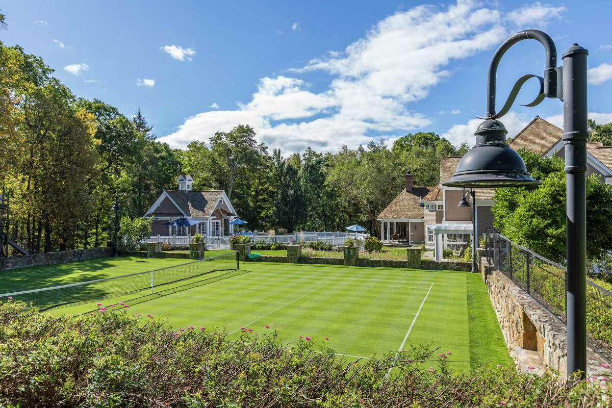 This West Mountain Rd. home in Ridgefield features an outdoor grass sports court that can be used for tennis, croquet, and golf putting; it can be converted into an ice skating/hockey rink in the winter.