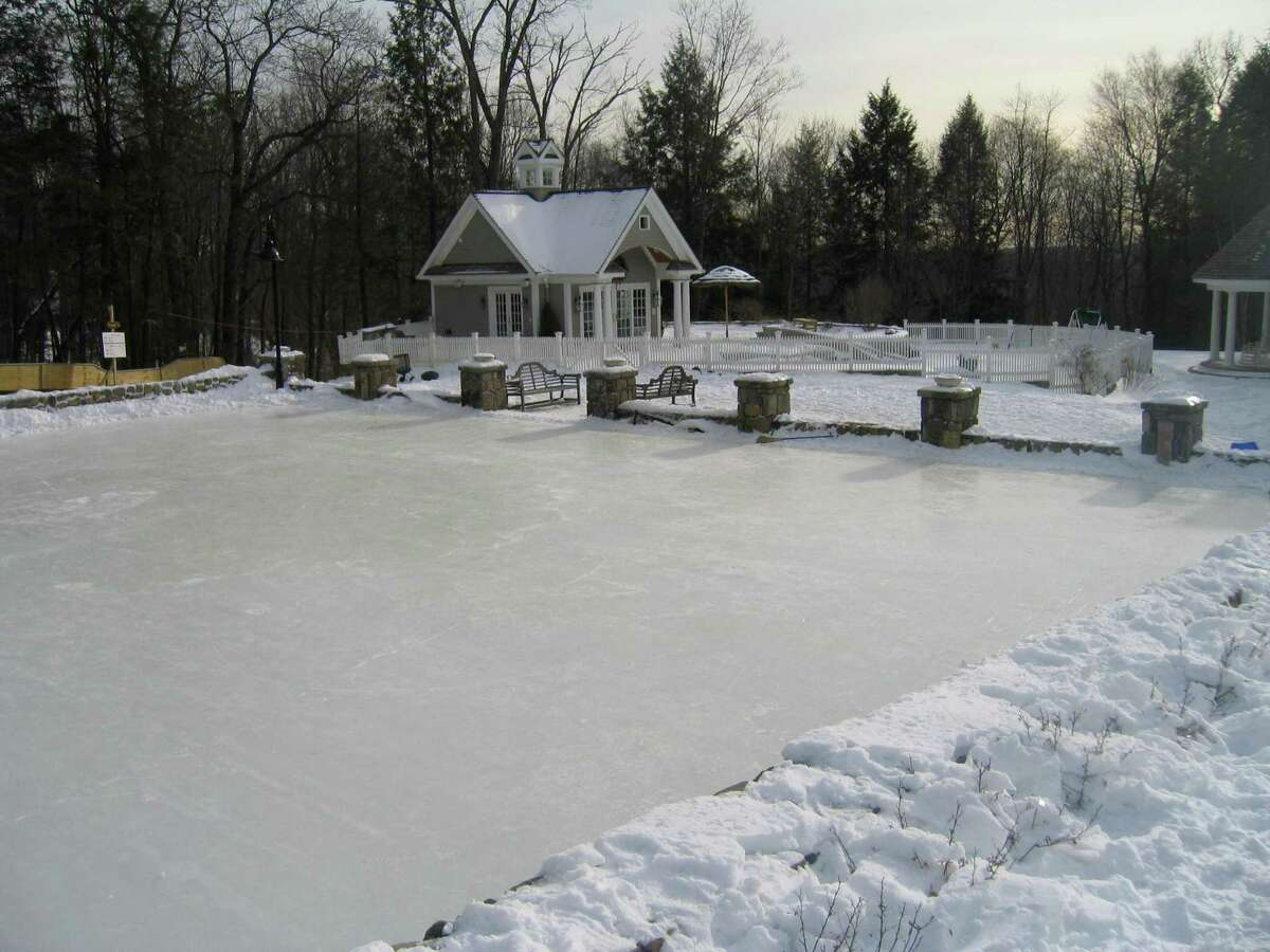 Here, the West Mountain Rd., Ridgefield home's outdoor grass sports court has been transformed into an ice skating/hockey rink for the winter.