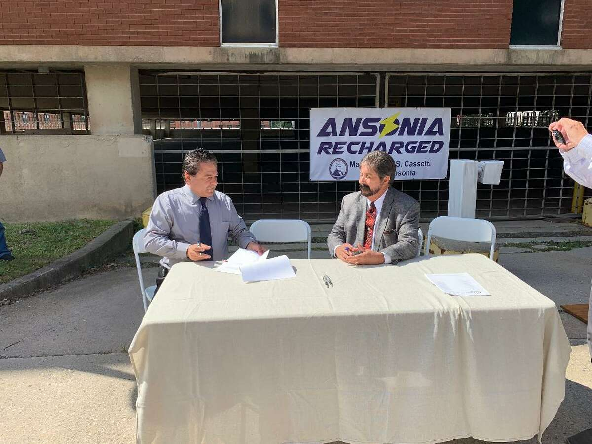 Ansonia Mayor David Cassetti signs a $11,599,000 contract with Frank Pullano, president of Banton Construction Co. of North Haven to refurbish the former Farrel Corporation headquarters into the new police station.