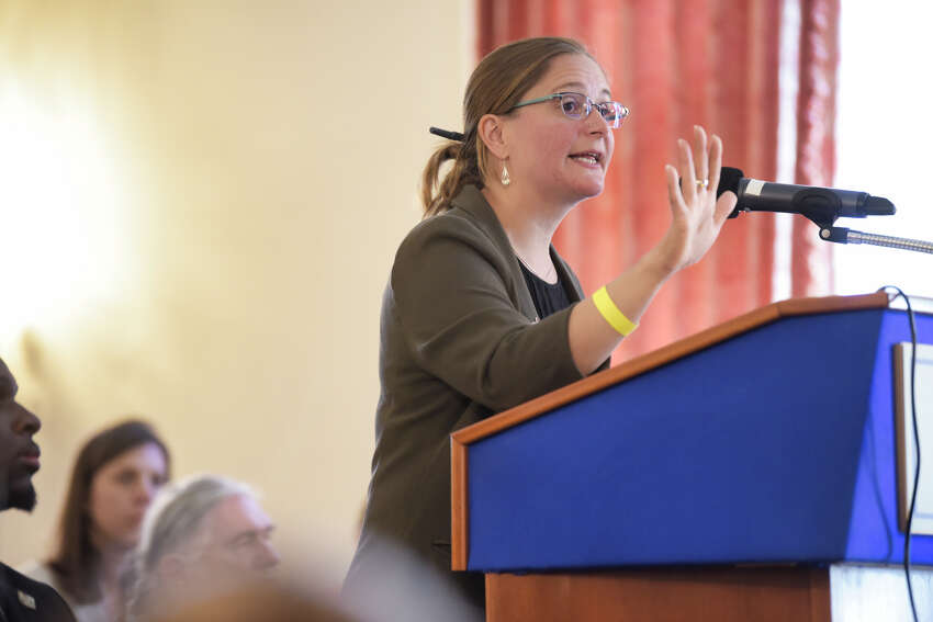 Jessica Wisneski, co-director of Citizen Action New York, testifies at a hearing held by the New York Public Campaign Finance Commission at the Rockefeller Institute of Government on Wednesday, Sept. 18, 2019, in Albany, N.Y. (Paul Buckowski/Times Union)