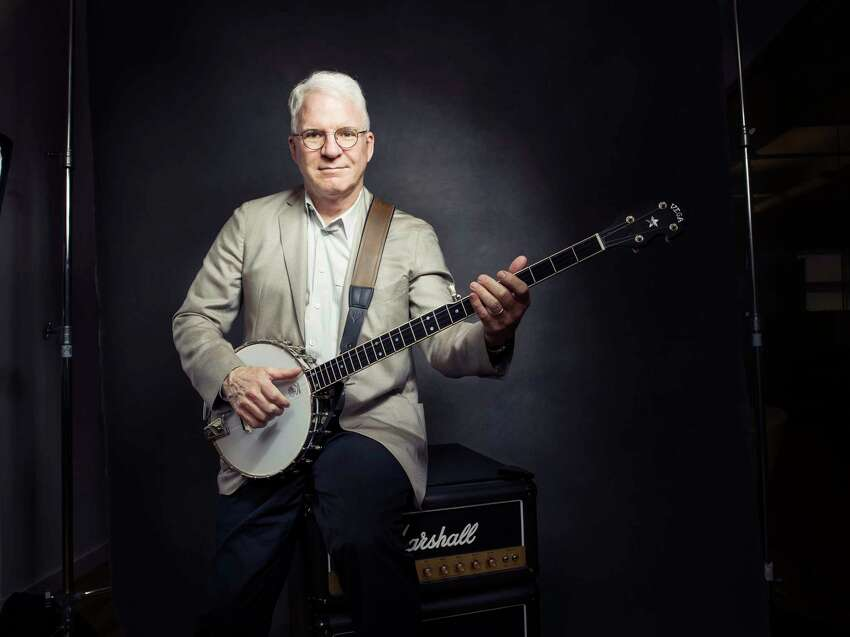 In this Sept. 2, 2015 photo, Steve Martin poses for a portrait with his banjo in New York. Martin said the Steve Martin Prize for Excellence in Banjo and Bluegrass, which comes with a $50,000 prize and a sculpture, is in danger of disappearing because he and the prize board members are overwhelmed by the sheer number of qualified musicians. Martin hopes some entity might take over administrating the prize. (Photo by Victoria Will/Invision/AP)