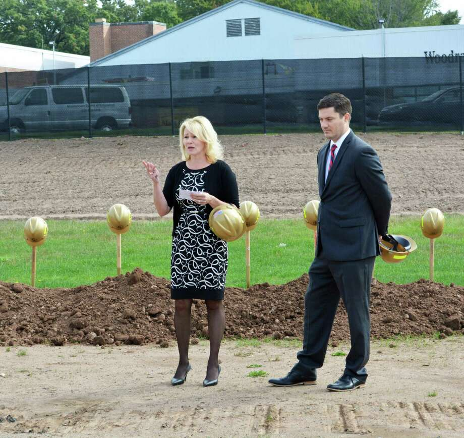Common Council Deputy Majority Leader Mary Bartolotta, chairwoman of the middle school building committee, and Christopher Drake, chairman of the Board of Education, take part in the ceremonial groundbreaking for the new Woodrow Wilson Middle School in Middletown. Photo: Hearst Connecticut Media File Photo