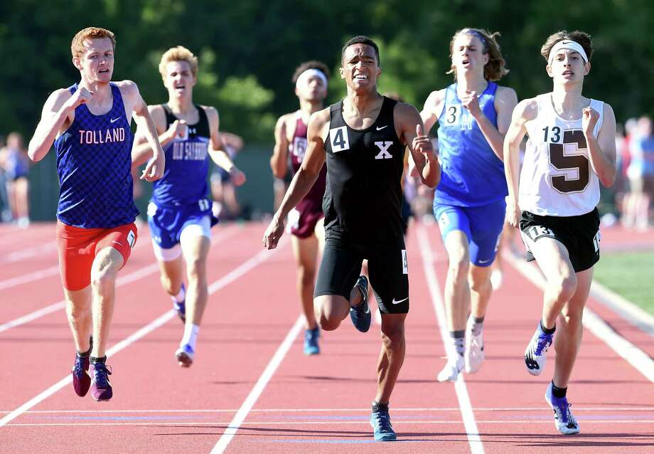 Xavier's Pierre Sylvain, center, inches out runners to win the 800 meters at last year's State Open. Xavier and Mercy announced that they will be combining their programs going forward. Photo: Arnold Gold / Hearst Connecticut Media / New Haven Register