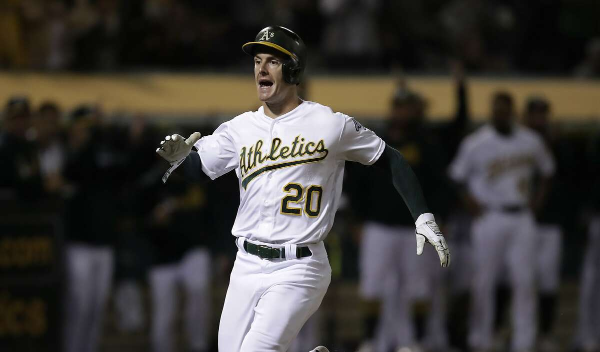 Oakland Athletics' Mark Canha celebrates after scoring against the Kansas City Royals during the seventh inning of a baseball game Tuesday, Sept. 17, 2019, in Oakland, Calif. (AP Photo/Ben Margot)