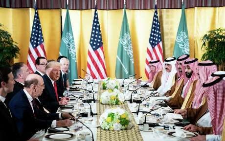"President Donald Trump speaks to a Saudi delegation led by Crown Prince Mohammad Bin Salman during a working breakfast on day two of the G-20 Summit in Osaka, Japan, June 29, 2019. After oil installations were blown up in Saudi Arabia on Saturday, Sept. 14, 2019, Trump declared that the United States was ""locked and loaded,"" a phrase that seemed to suggest he was ready to strike back. But then he promised to wait for Saudi Arabia to tell him ""under what terms we would proceed."""