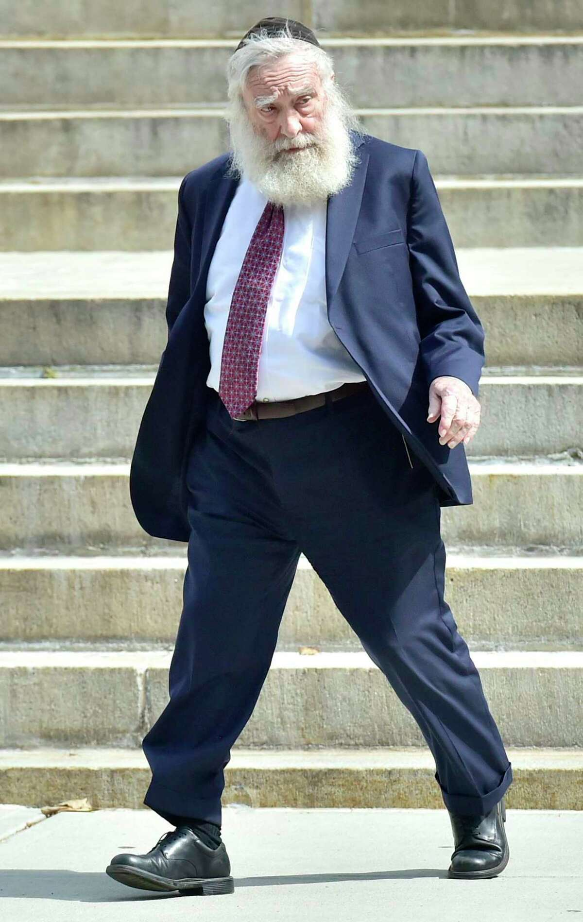 Rabbi Daniel Greer, 77, of New Haven, leaves New Haven Superior Court on Elm Street in New Haven, Conn. Monday, August 14, 2017 after he was arraigned on a criminal charge of second-degree sexual assault and risk of injury to a minor. Greer did not enter a plea. The alleged victim in the criminal charge is Eliyahu Mirlis, of New Jersey, who was awarded $15 million in in his civil lawsuit against Greer in May of 2016. Greer was a dean of the Yeshiva of New Haven/the Gan School, where the alleged victim was a high school student. Greer was accused in May 2016 of repeatedly sexually assaulting Mirlis, of New Jersey, over several years in the early- to mid-2000s. Mirlis attended the school from 2001 to 2005. Greer has denied the allegations.