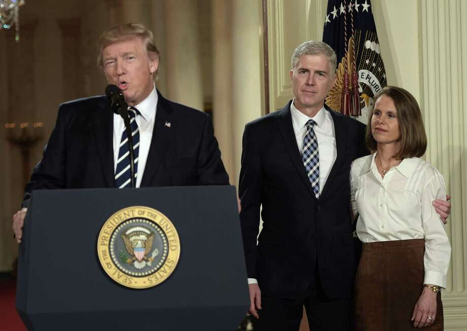 Judge Neil Gorsuch and his wife, Marie Louise, look on as Donald Trump nominates him for the Supreme Court on Jan. 31, 2017. Trump nominated Gorsuch after the Republican-controlled U.S. Senate refused to allow a confirmation hearing of President Barack Obama's Supreme Court nominee. Photo: Brendan Smialowski /Getty Images / AFP or licensors