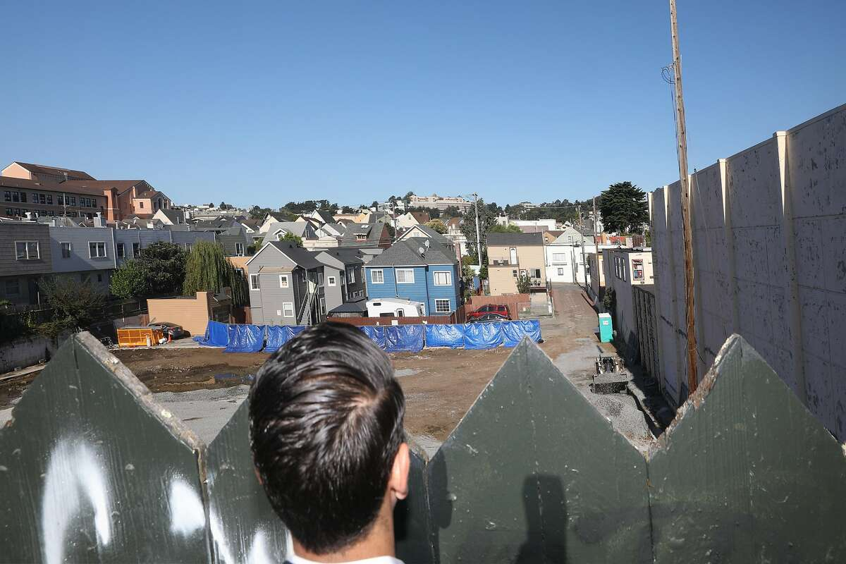 Developer Cyrus Sanandaji (middle) from Presidio Bay Ventures takes a peak at construction on housing project starting at 915 Cayuga next door from part of his housing project located at 65 Ocean Ave. on Tuesday, Sept. 17, 2019 in San Francisco, Calif.