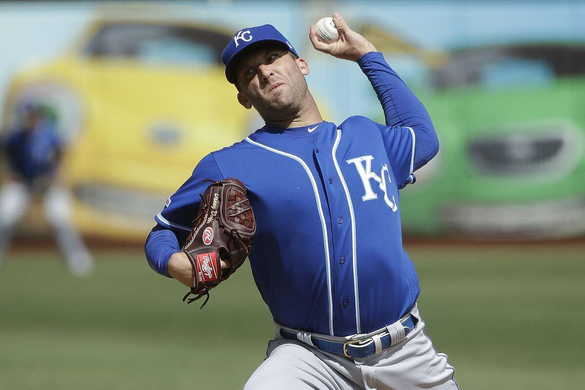 Kansas City Royals pitcher Danny Duffy throws to an Oakland Athletics batter during the first inning of a baseball game in Oakland, Calif., Wednesday, Sept. 18, 2019. (AP Photo/Jeff Chiu)