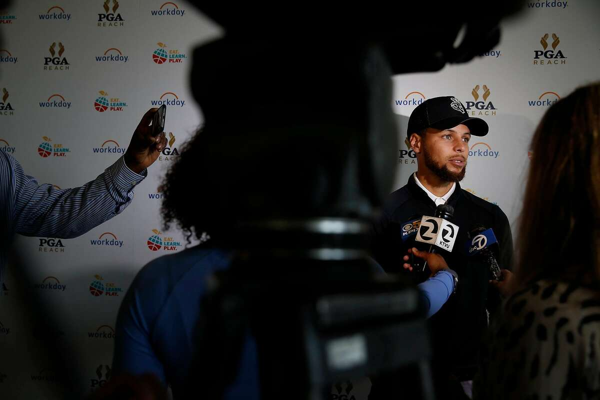 Warriors guard Stephen Curry answers questions from the media at the Steph Curry Charity Classic at Harding Park on Sept. 16, 2019.