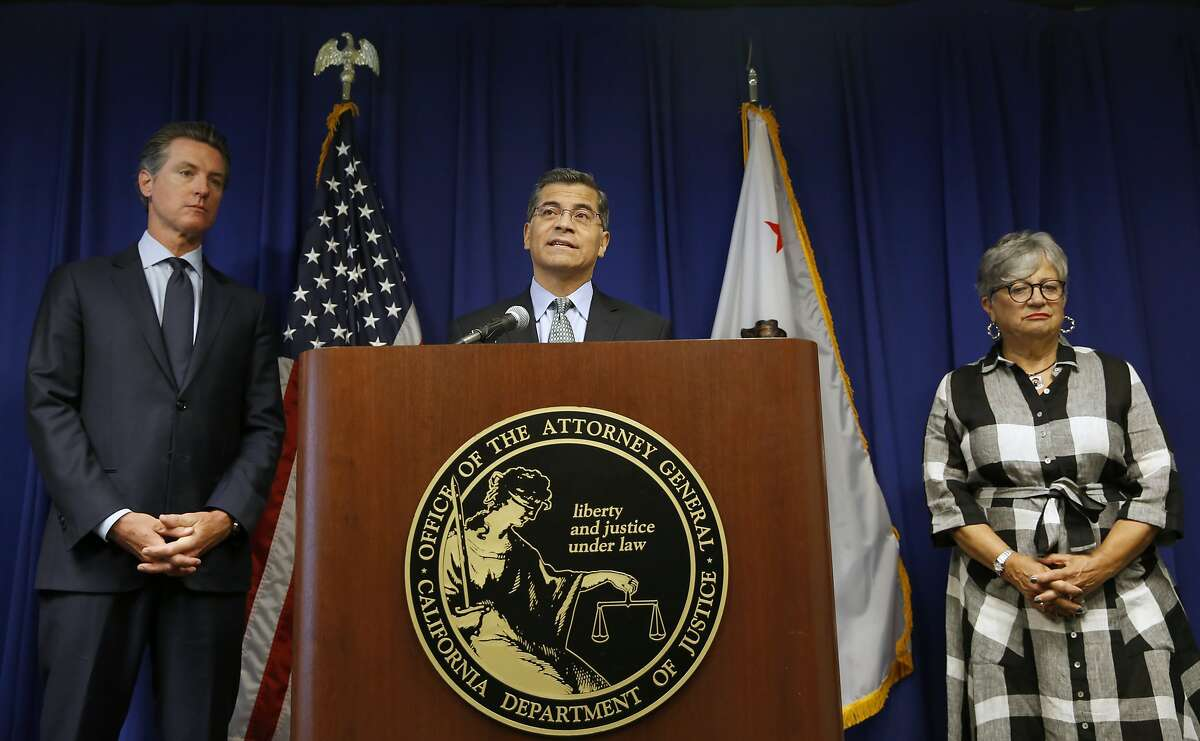 California Attorney General Xavier Becerra, center, flanked by Gov. Gavin Newsom, left, and California Air Resources Board Chair Mary Nichols, discusses the Trump administration's pledge to revoke California's authority to set vehicle emissions standards that are different than the federal standards, during a news conference in Sacramento, Calif., Wednesday, Sept. 18, 2019.