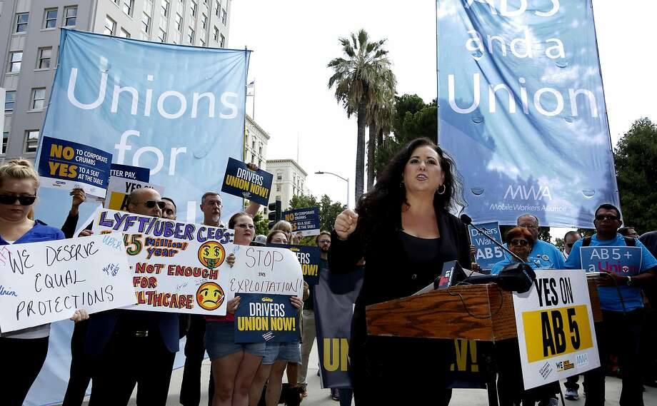 Assemblywoman Lorena Gonzalez, D-San Diego, speaks at an August rally for her AB5 gig-work bill. The bill, which will turn some contractors into employees, passed last month and Gov. Newsom signed it into law. Photo: Rich Pedroncelli / Associated Press