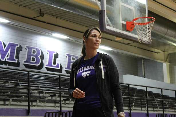 Humble head coach Michelle Funderburk working with the Lady Wildcats during practice