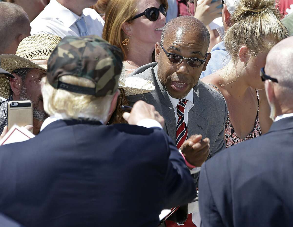 """In this photo taken Friday, June 3, 2016, Republican presidential candidate Donald Trump, left, talks to Gregory Cheadle as he leaves a campaign rally at the Redding Municipal Airport, in Redding, Calif. Cheadle, whom Trump singled out while calling him """"my African-American,"""" said Monday that he is now the target of harsh criticism, including comments he feels are more racist than the remark by the presumptive Republican presidential nominee. Cheadle also said Monday that he was not there to back Trump and that he is considering other possibilities as well, including Democratic candidate Sen. Bernie Sanders. (AP Photo/Rich Pedroncelli)"""