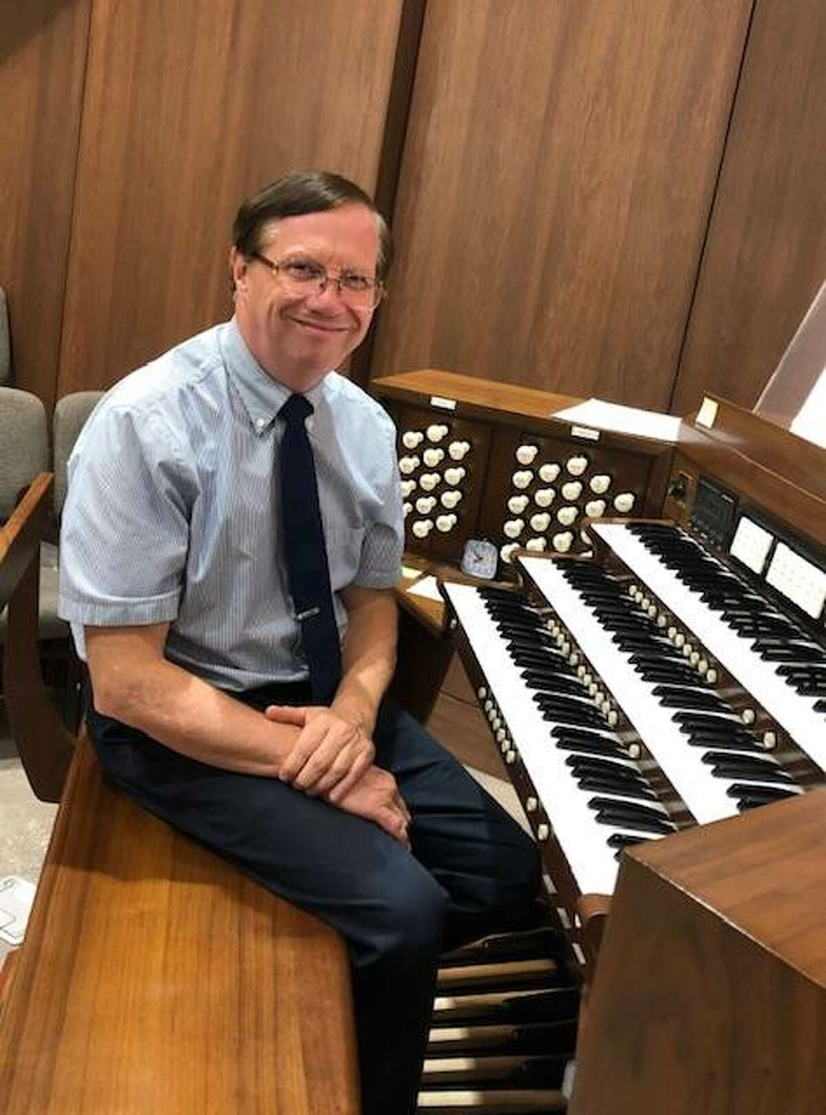 Robert Raymond, First Presbyterian Church Organist, poses for a photo at his new station.