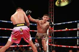 """Midland boxer Michael Dutchover, right, is shown here boxing Rosekie Cristobal on May 10 in a ShowBox: The New Generation"""" bout in Corona, Calif. Courtesy of Showtime"""