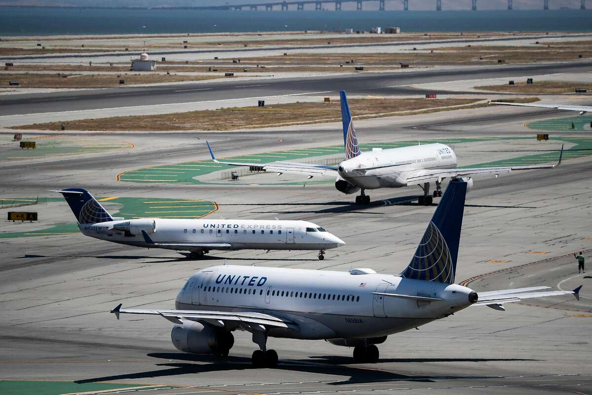 United Airlines aircrafts taxi along runway 28L at San Francisco International Airport in San Francisco, Calif. on Monday, August 26, 2019.