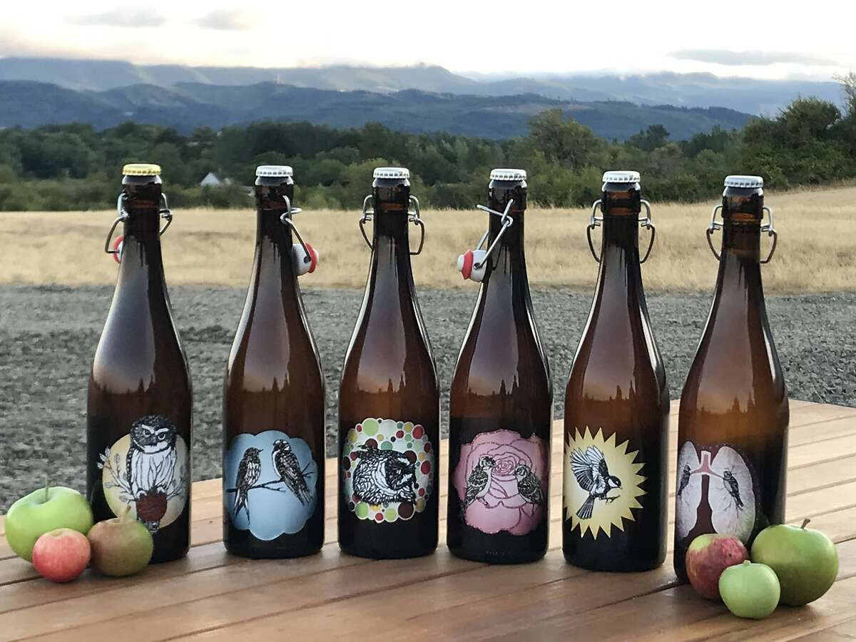 The lineup of ciders at Art+Science in Oregon. Co-owner Kim Hamblin designs the labels from cut paper.