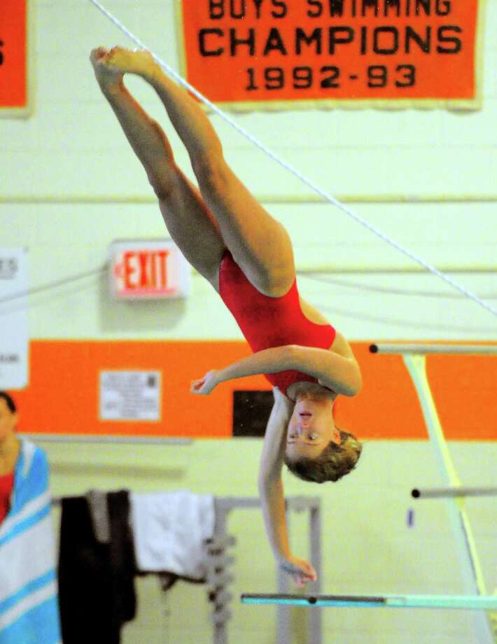 Greenwich's Saylor Kirsch won the CIAC Class LL diving finals at Middletown High School on Wednesday. Photo: Christian Abraham / Hearst Connecticut Media / Connecticut Post