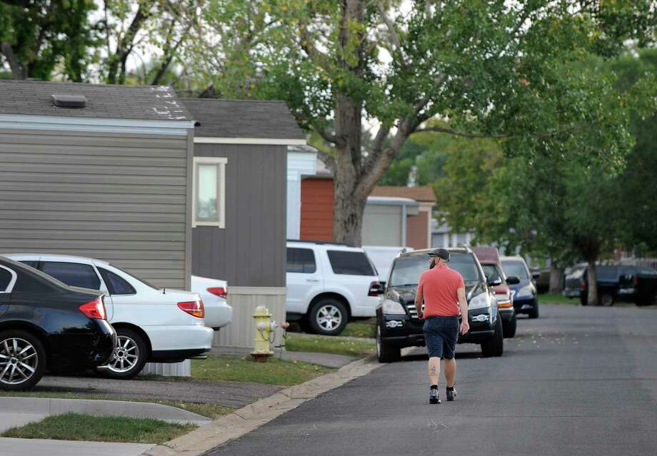 ADVANCE ON THURSDAY, SEPT. 12 FOR USE ANY TIME AFTER 3:01 A.M. SUNDAY SEPT 15 - In this Aug. 30th 2019 photo shows residents of Lamplighter Village, a manufactured and mobile home park, spending time outdoors in their community in Federal Heights, Colo. Across Colorado, where the housing crisis impacts both rural and urban towns, the strife between mobile home park residents and park owners approaches a boiling point. The business model -- in which homeowners pay lot rent to park their houses on someone else's land -- capitalizes on the immobility and economic fragility of tenants who often can't afford to move or live anywhere else.(Kathryn Scott/The Colorado Sun) Photo: Kathryn Scott, MBR / Associated Press / The Colorado Sun