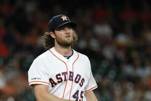 Houston Astros starting pitcher Gerrit Cole (45) reacts after striking out Texas Rangers Ronald Guzman in the second inning of an MLB baseball game at Minute Maid Park, Wednesday, Sept. 18, 2019, in Houston.