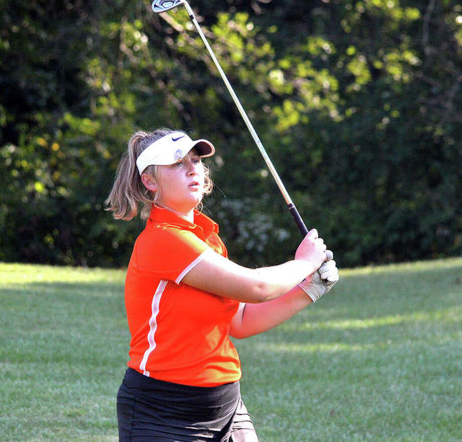 Edwardsville's Riley Burns watches the flight of her second shot on hole No. 3 at Spencer T. Olin Golf Course during Wednesday's triangular match against Marquette and Triad.