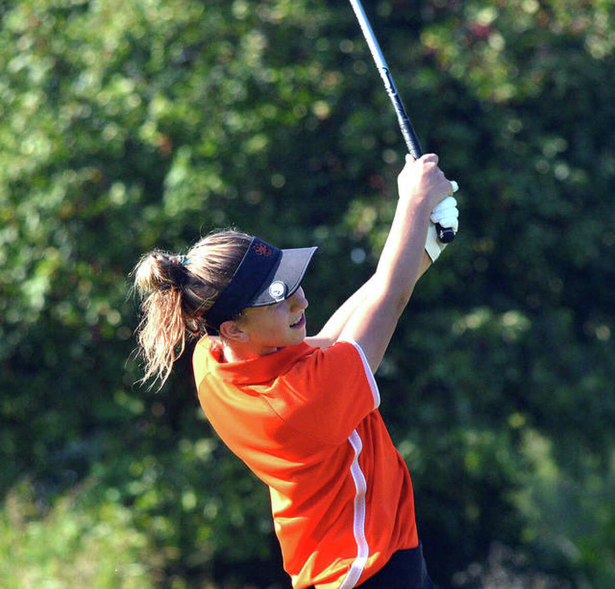 Edwardsville's Grace Daech hits a tee shot on No. 7 at Spencer T. Olin Golf Course during Wednesday's triangular match against Marquette and Triad.