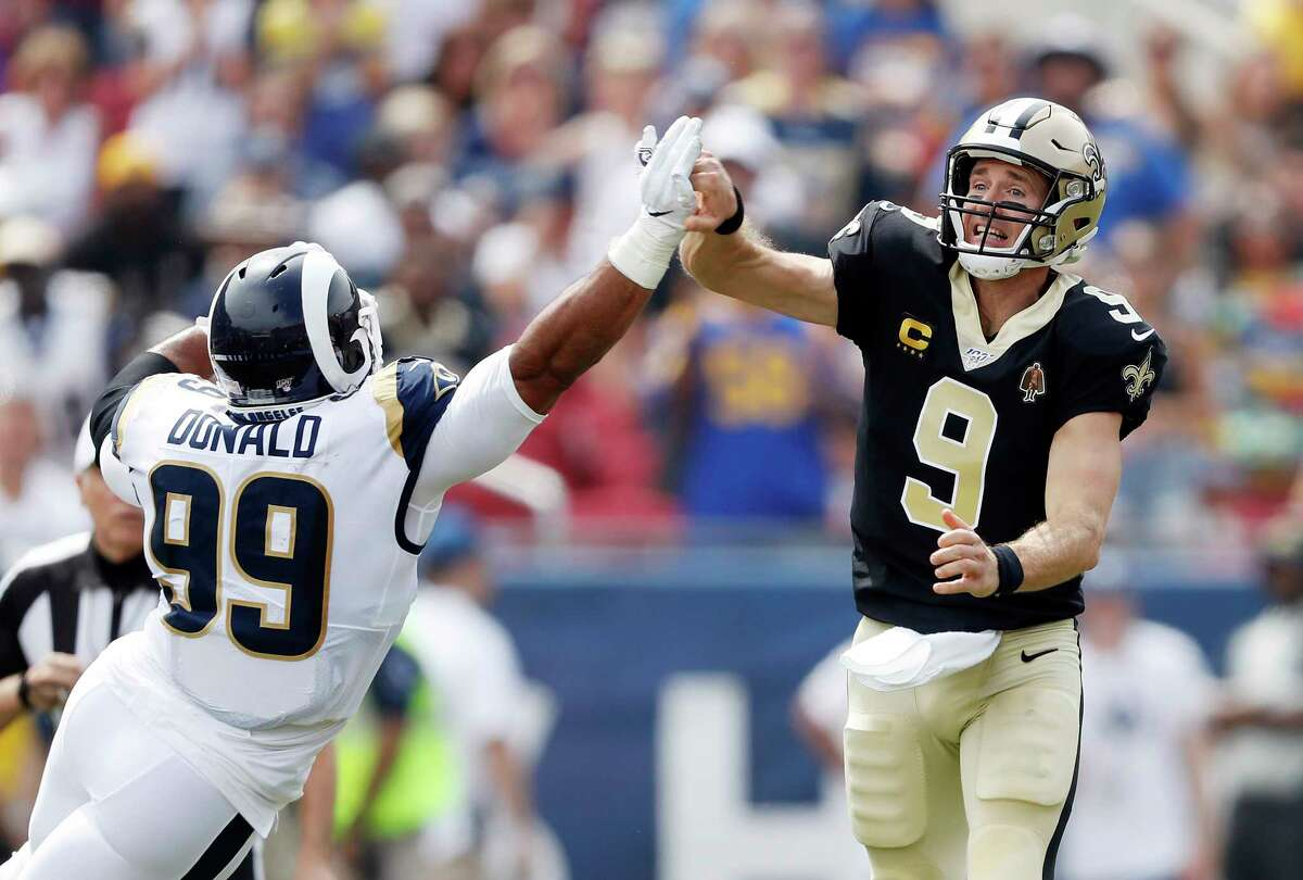 LOS ANGELES, CALIFORNIA - SEPTEMBER 15: Drew Brees #9 of the New Orleans Saints injures his throwing hand as he is hit by Aaron Donald #99 of the Los Angeles Rams during the first quarter in the game at Los Angeles Memorial Coliseum on September 15, 2019 in Los Angeles, California. (Photo by Sean M. Haffey/Getty Images)