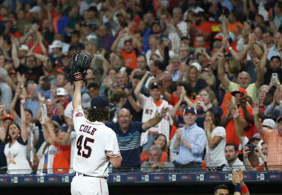 Astros starting pitcher Gerrit Cole (45) waves to the fans after striking out Rangers batter Shin-Soo Choo in the sixth inning to record his 300th strikeout this season during Wednesday's 3-2 victory at Minute Maid Park. Photo: Karen Warren, Staff Photographer / © 2019 Houston Chronicle