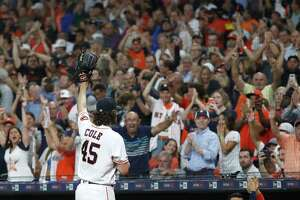 Houston Astros starting pitcher Gerrit Cole (45) waves to the fans after striking out Texas Rangers Shin-Soo Choo in the sixth inning to record his 300th strikeout this year during an MLB baseball game at Minute Maid Park, Wednesday, Sept. 18, 2019, in Houston.