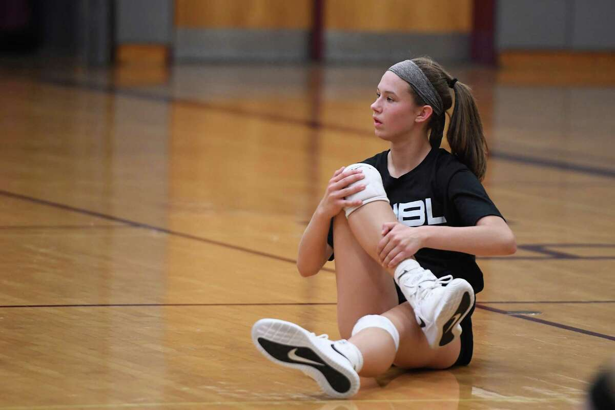 Burnt Hills-Ballston Lake outside hitter Carlie Rzsezortarski stretches while her coach (not shown) speaks at practice on Wednesday, Sept. 18, 2019, in Burnt Hills, N.Y. (Jenn March, Special to the Times Union)