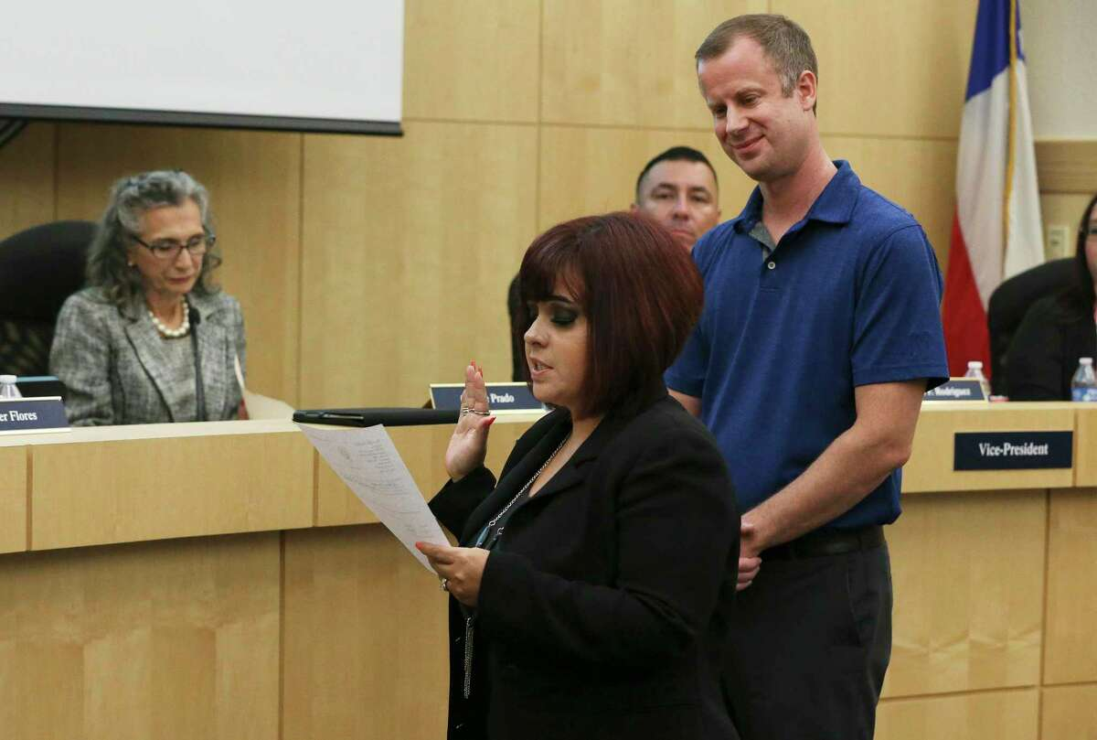 Stacey Alderete (front) and Kevin Rasco (back) take the oath of trustees as they were voted in as trustees during the South San school board meeting on Wednesday, Sept. 18, 2019. Alderete and Rasco replaced two of the three trustees who abruptly resigned recently.
