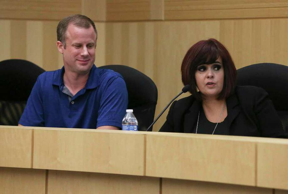 Newly sworn in trustees Kevin Rasco and Stacey Estrada Alderete take their seats on the South San ISD board, Wednesday. But before Alderete was appointed, voters had voted her off the school board. Photo: Kin Man Hui /Staff Photographer / ©2019 San Antonio Express-News