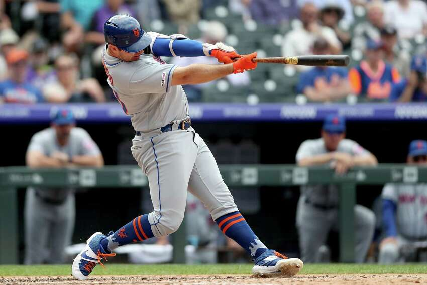 DENVER, COLORADO - SEPTEMBER 18: Pete Alonso #20 of the New York Mets hits a solo home run in the sixth inning against the Colorado Rockies at Coors Field on September 18, 2019 in Denver, Colorado. (Photo by Matthew Stockman/Getty Images)