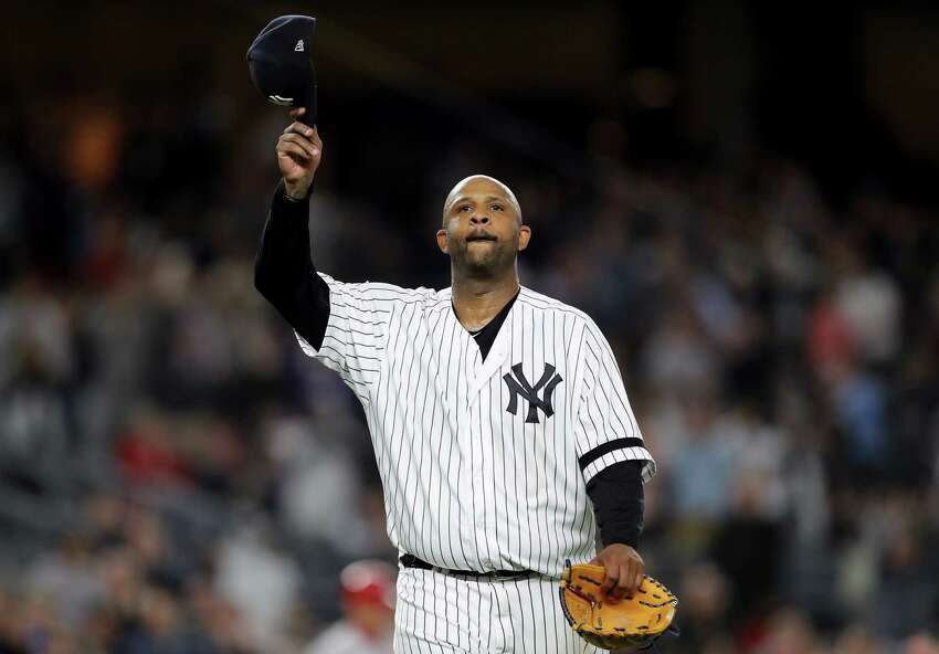 NEW YORK, NEW YORK - SEPTEMBER 18: CC Sabathia #52 of the New York Yankees salutes the fans as he is pulled from the game in the third inning against the Los Angeles Angels at Yankee Stadium on September 18, 2019 in the Bronx borough of New York City. (Photo by Elsa/Getty Images)