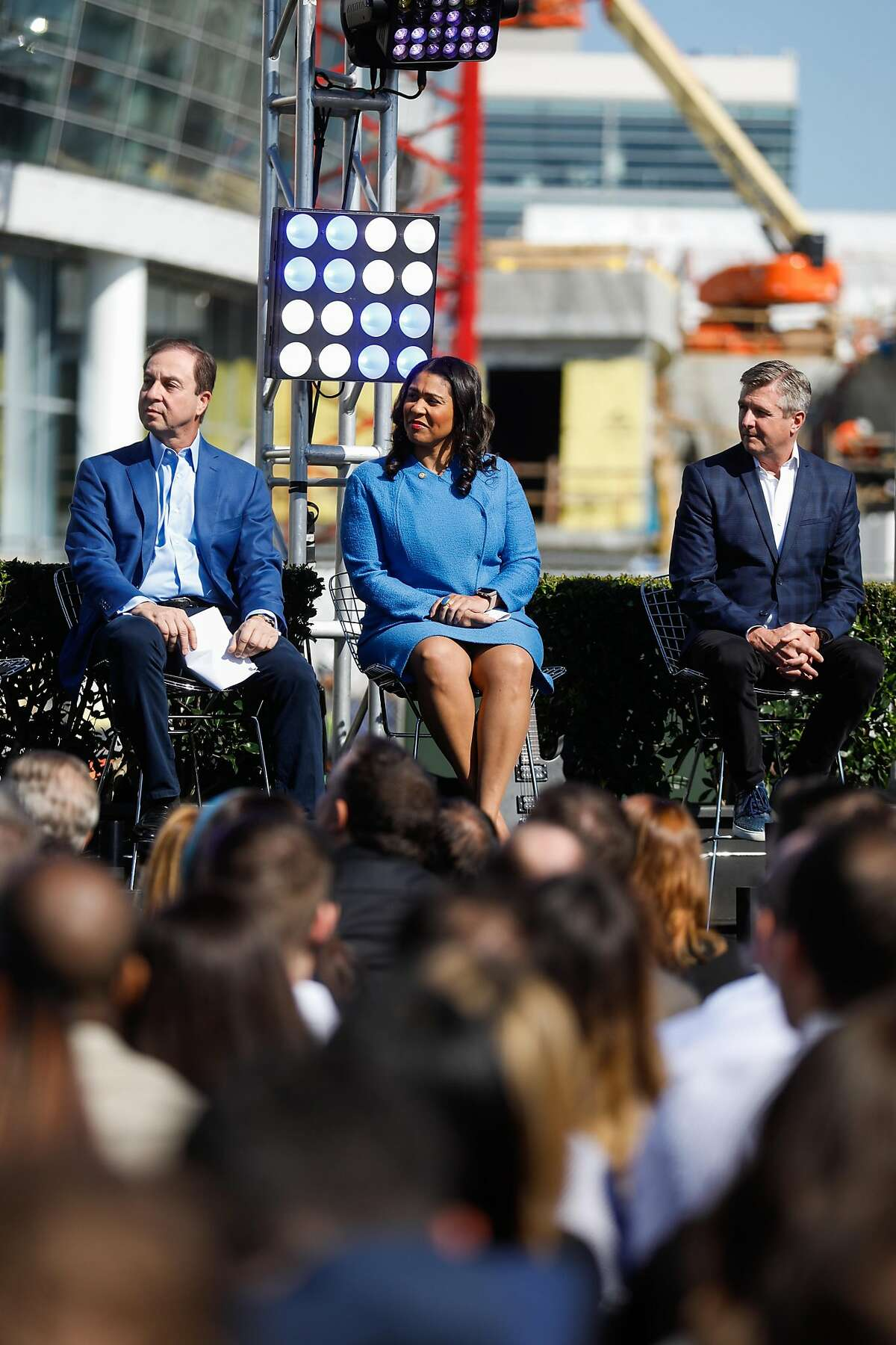 (l-r) Golden State Warriors owner Joe Lacob, Mayor London Breed and Warriors president and COO Rick Welts listen during a press conference which announced Metallica as the first performer at the Chase Center in San Francisco, Calif., on Monday March 18, 2019.