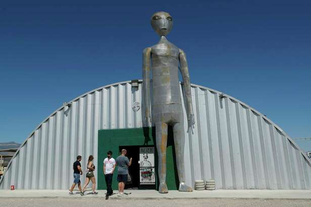 "People enter and exit the Alien Research Center in Hiko, Nev. No one knows what to expect, but lots of people are preparing for ""Storm Area 51"" on Wednesday, Sept. 18, 2019, in the Nevada desert. Neighbors, elected officials and experts say the craze sparked by an internet joke inviting people to """"see them aliens"" might become a cultural marker, a dud or something in-between."