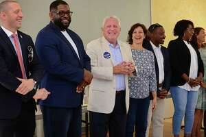Norwalk Mayor Harry Rilling, center, celebrates the kickoff of his campaign with Common Council candidates Saturday, September 7, 2019, at the Norwalk DTC campaign headquarters on North Main Street in Norwalk, Conn. He was joined by local, state and federal officials, including Congressman Jim Himes.
