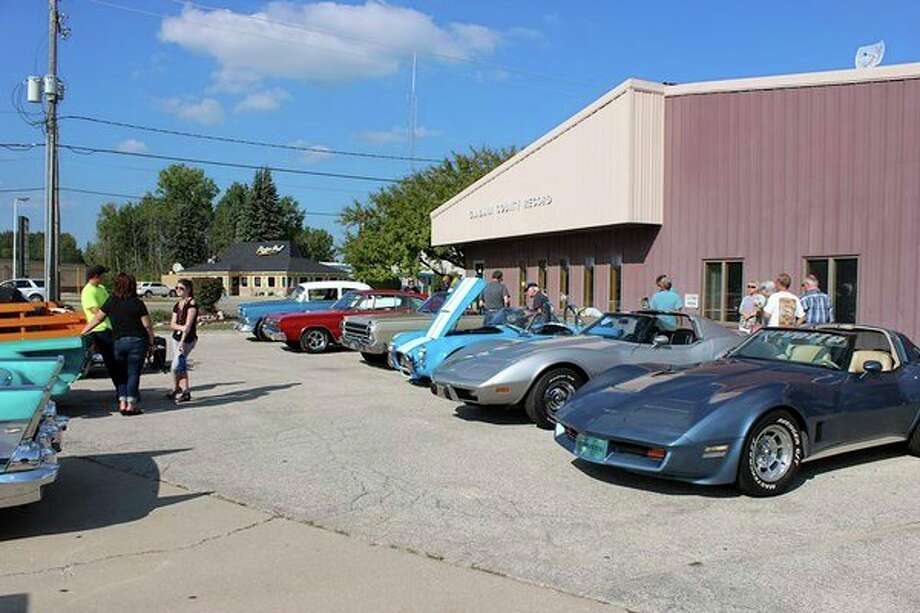 Car enthusiasts admire vintage cars during the first Cruisin' Classic Car Show hosted by the Gladwin Record in September 2019. The event is set for a second year at the Gladwin Community Center Sept. 21 from 4 to 8 p.m. There are spots still available for those wishing to show off their classic cars. Call 989-426-9411. (Photo courtesy of the Gladwin County Record)