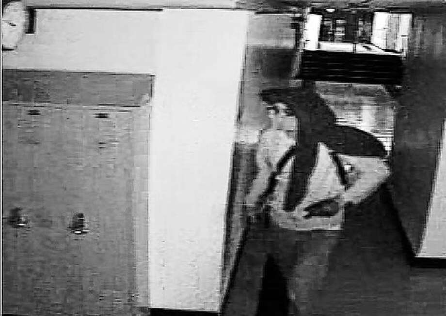 Stills from surveillance video show the person suspected of breaking into A-C Central and taking tools and equipment from classrooms. Photo: Photos Provided