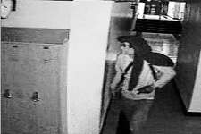 Stills from surveillance video show the person suspected of breaking into A-C Central and taking tools and equipment from classrooms.
