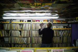 Employee Chris Lawrence organizes records at Last Vestige Music Shop on Wednesday, Sept. 18, 2019, in Albany, N.Y.  (Paul Buckowski/Times Union)