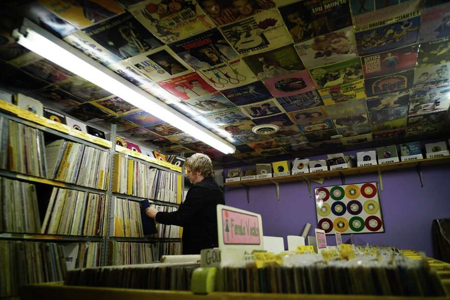 Employee Chris Lawrence organizes records at Last Vestige Music Shop on Wednesday, Sept. 18, 2019, in Albany, N.Y.  (Paul Buckowski/Times Union) Photo: Paul Buckowski, Albany Times Union / (Paul Buckowski/Times Union)