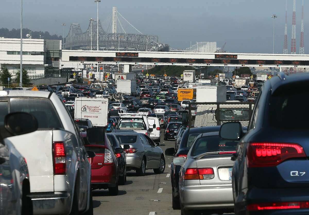 OAKLAND, CA - JULY 02: Commuter traffic backs up at the toll plaza to the San Francisco-Oakland Bay Bridge on July 2, 2013 in Oakland, California. For a second day, hundreds of thousands of San Francisco Bay Area commuters are scrambling to find ways to work after two of San Francisco Bay Area Rapid Transit's (BART) largest unions went on strike early yesterday morning following contract negotiations with management falling apart the day before. Train operators, mechanics, station agents and maintenance workers are seeking a five percent wage increase and are fighting management who want to have workers to begin contributing to their pensions, pay more for health insurance and reduce overtime expenses. (Photo by Justin Sullivan/Getty Images)